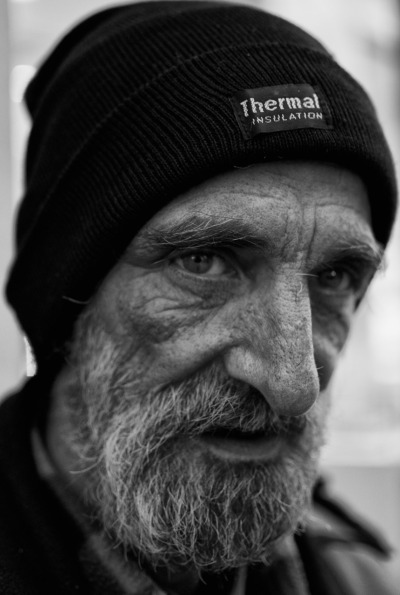 "Jay is 59 years old and has been selling the Big Issue for over 11 years. He is homeless and depends on the money from the issue to eat and get by. He works Monday-Friday from 7am-6pm. In the mornings he works on Waterloo Bridge and in the afternoons he works on Long Acre road in Covent Garden. He used to work every single day but found that the weekends were very slow and he made very little money on them. He buys the Big Issue for £1, which is half the price he sells it for which is £2. Depending on the day and location he can sell between 15-20 issues earning him between £15-£20 a day which for the amount of hours he works is very little. It can be a very lonely and boring job where he may go for hours without selling an issue. He makes the majority of his money through his regulars whom he has also built relationships with. Some regulars have been buying the issue from him for over 7 years. This is something he has built up over time and rarely makes any sales to strangers walking by. People tend to just walk by without even noticing Jay. The ones that do pretend to be on their phones or even on some occasions take a different route just so that they don't come into eye contact with him. His approach is not like other sellers who shout out ""Big Issue"" ""Big Issue."" He just stands there as still as a statue as he believes that people have a choice to buy and should not be forced to or guilt tripped into buying. He is an intelligent, softly spoken man who has experienced a lot in his life and works very hard at selling the Big Issue in order to survive."