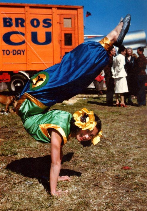 theniftyfifties:  A young circus contortionist does a handstand, 1950.