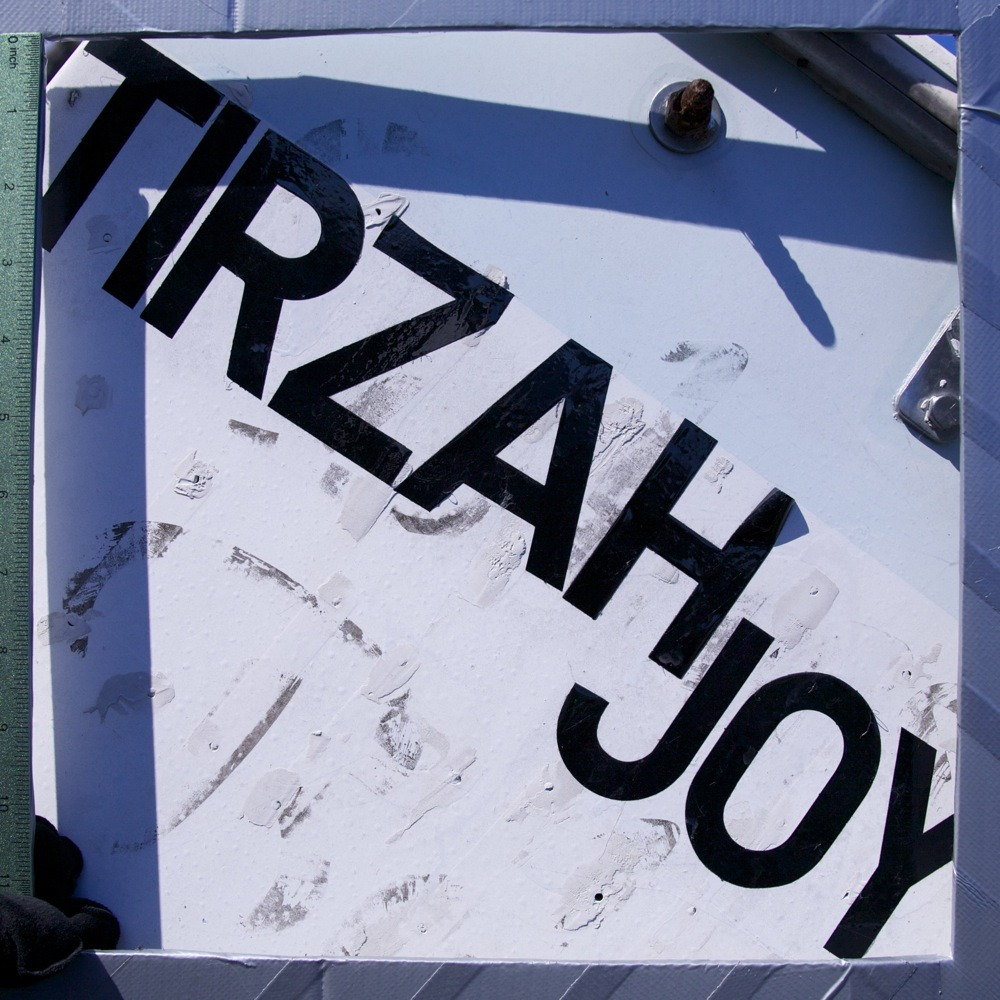 "Name lettered on small boat, ""TIRZAH JOY"", N Vanderbilt St."