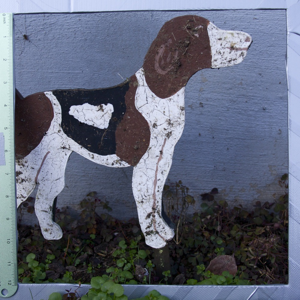 Painted metal brown, black and white dog sculpture kitsch, N Vanderbilt St.