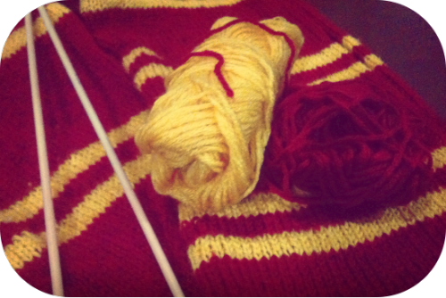 Finished Project: Gryffindor ScarfNeedles used: 4mm bambooSkeins of yarn used: I forgot… maybe 6? 7?Time taken: 100 consecutive hoursFinally finished the Gryffindor scarf I've been knitting on-and-off for the past few months. I did the math and I've spent a bit over 100 hours knitting it. Broke my heart a little when I remembered it was for a friend. ;_; (If you knit, you'd understand) It's so soft and gahhh!! I cuddled it one last time before giving it away. I knitted 2 full-length sides in stockinette and stitched them together. Stitch count:Width: 44 stitchesLength: 604 stitchesDouble sided, so multiply by 2Grand Total: 53,152 stitches PS. My friend was really happy when she received it. I'm glad. ^^ It's okay… I'll knit one more for myself… ohohohoho xD
