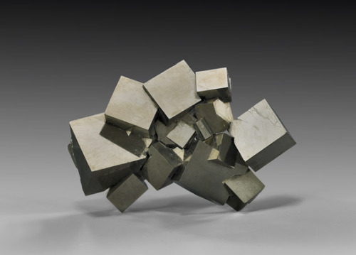suchasensualdestroyer:  Pyrite cluster. For those too young to remember: this is exactly what corporate sculpture was like in the 80s.