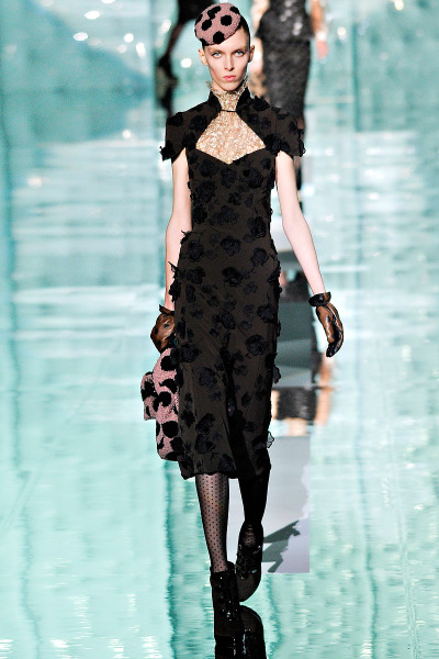 Marc Jacobs Fall RTW 2011 Model: Chloe Memisevic  This Rose Vine Guipure Dress is $4,200.00 (link to MJ's online store) even with receiving an email yesterday of a 40% discount, a mere mortal still can't buy this beautiful black lace dress (if you go to Jacobs' online store, this dress has an open back).