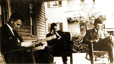 Thomas Wolfe and unidentified frat brothers read.