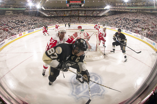 Sidney Crosby and Mikael Samuelsson fight for a loose puck during Game 6 of the 2008 Stanley Cup Finals. Crosby is just one of 22 NHL players currently sidelined by head injury, writes SI.com's Stu Hackel. (David E. Klutho/SI) HACKEL: The NHL's worst nightmare coming true as head injuries increaseVIDEO: Explaining Crosby's symptoms | How Pens should manage CrosbyPHOTO GALLERY: Notable hockey careers cut short by concussion