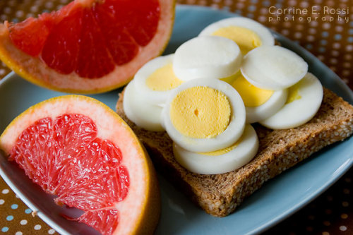 Whole wheat Toast with two hard boiled eggs and a side of grapefruit