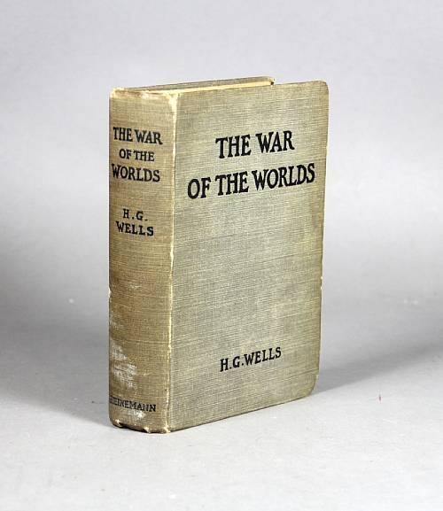 "The War of the Worlds Herbert George Wells. London: William Heinemann, 1898.  Original gray cloth stamped in black. Faint toning, hinges partially cracked, cloth somewhat rubbed at joints and extremities, a few stray marks, spine slightly darkened.  FIRST EDITION, FIRST ISSUE with 16-page Autumn 1897 publisher's catalogue inserted at rear. Currey pp 526-7.  B-A Note:  Trivia: As many of you know, Orson Welles directed a radio drama in 1938 based on this book. It had a news-bulletin format and aired without commercials, leading many to believe it was a real news alert.  Per wiki:  ""In the days following the adaptation, however, there was widespread outrage and panic by certain listeners who had believed the events described in the program were real. The program's news-bulletin format was decried as cruelly deceptive by some newspapers and public figures, leading to an outcry against the perpetrators of the broadcast. The episode secured Welles's fame."" ———————————————-""No one would have believed in the last years of the nineteenth century that this world was being watched keenly and closely by intelligences greater than man's and yet as mortal as his own; that as men busied themselves about their various concerns they were scrutinised and studied, perhaps almost as narrowly as a man with a microscope might scrutinise the transient creatures that swarm and multiply in a drop of water. With infinite complacency men went to and fro over this globe about their little affairs, serene in their assurance of their empire over matter. It is possible that the infusoria under the microscope do the same. No one gave a thought to the older worlds of space as sources of human danger, or thought of them only to dismiss the idea of life upon them as impossible or improbable. It is curious to recall some of the mental habits of those departed days. At most terrestrial men fancied there might be other men upon Mars, perhaps inferior to themselves and ready to welcome a missionary enterprise. Yet across the gulf of space, minds that are to our minds as ours are to those of the beasts that perish, intellects vast and cool and unsympathetic, regarded this earth with envious eyes, and slowly and surely drew their plans against us. And early in the twentieth century came the great disillusionment. "" - Opening Paragraph, The War of the Worlds"