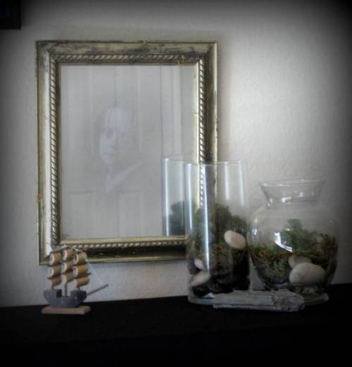 Haunted mirrors: half-silvered glass over creepy pictures | via Boing Boing