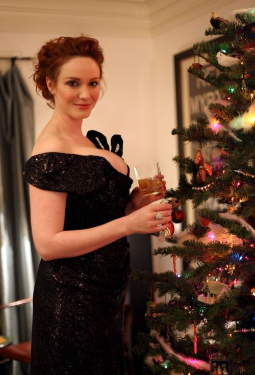 whosthegirlwearingthedress:ffamouspeople:Christina Hendricks celebrates the holidays at her home in Los Angeles - December 10 2011 Is it comfortable for your bobs to do that? I just want to know. I suppose it