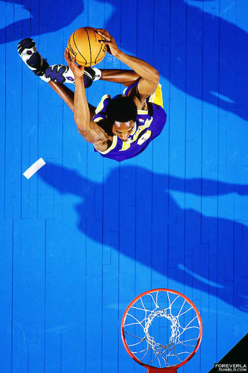 foreverla:  Throwback Photo of the Day: A young Kobe Bryant rises up for a dunk.