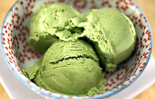 reblogged from veganasfuck:  Green Tea Ice CreamMakes about 1 quart 2 tablespoons arrowroot2 cups soymilk2 cups soy creamer¾ cup sugar2 tablespoons matcha (green tea powder), sifted to remove lumps¾ teaspoon vanilla extract½ teaspoon almond extract 1. Stir the arrowroot into ¼ cup of the soymilk until dissolved. Set aside. 2. Heat the remaining soymilk and creamer in a saucepan on medium heat, stirring occasionally. Stir more frequently as the mixture approaches a boil. 3. When the liquid is gently bubbling, whisk in sugar until dissolved, then matcha until dissolved (it will not actually dissolve, but will be in suspension). 4. Remove saucepan from heat and whisk in arrowroot mixture until dissolved. Then stir in the extracts. 5. Chill for several hours to overnight, then make according your ice cream maker's directions. You may need to freeze it for two hours after it comes out of the ice cream maker if you desire a thicker texture. Store unused ice cream in an airtight container in the freezer; it will be very hard right out of the freezer, but microwaving it for 15 seconds will soften it.  Green tea ice cream, my favorite! (Yeah, I say that about all the flavors, but this time I mean it!)