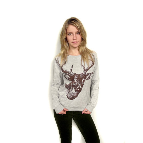 This adorable deer print sweatshirt from Toronto-based etsy-er Andrea Winkler's shop: BetterStayTogether is definitely on my wishlist (I am a major fan of pretty tops with a kangaroo pocket.) Reasonably priced at $32, pair this uber-cute top with dark skinny jeans and a pair of cognac riding boots.