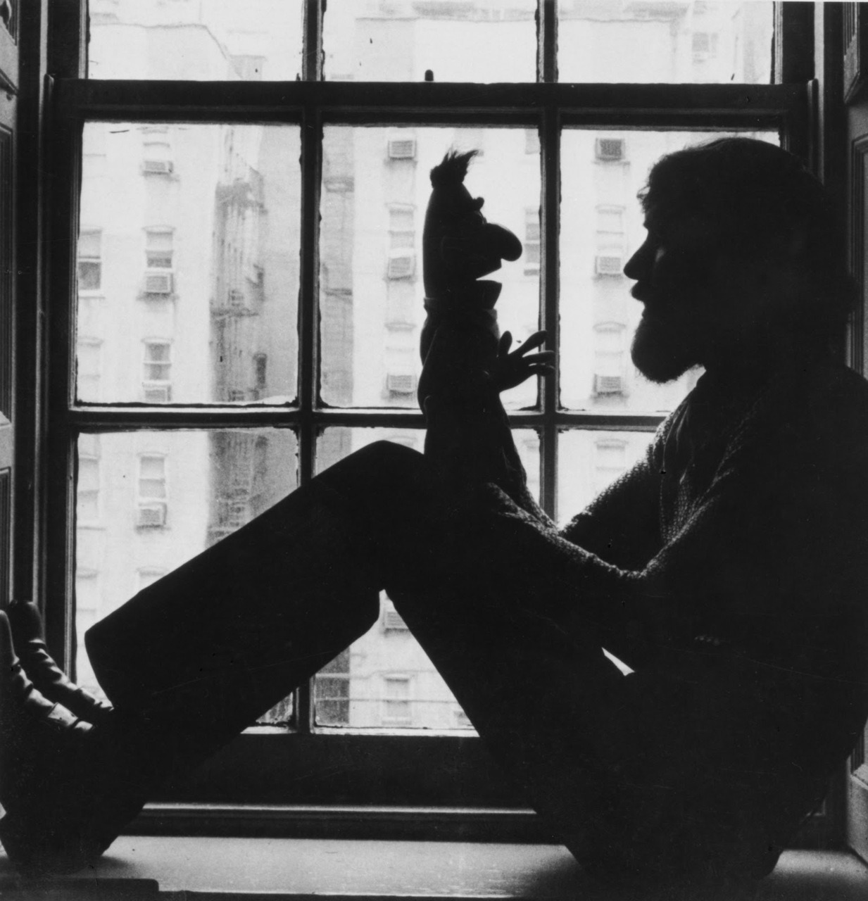 Jim Henson and Kermit the Frog.