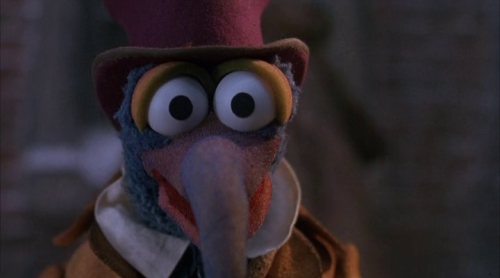 Gonzo as a weird Charles Dickens. The Muppet Christmas Carol (1992), directed by Brian Henson and starring Jim Henson's Muppets with Michael Caine as Ebenezer Scrooge. Based on A Christmas Carol by Charles Dickens