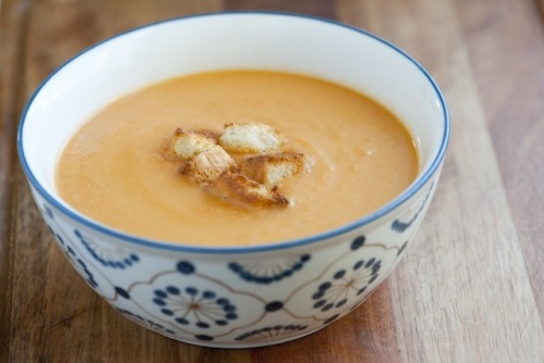 fitbodyfitsoul:  prettybalanced:  Vegetable Soup   Creamy Vegetable Soup Recipe  This  soup can be refrigerated up to 3 days and kept in the freezer for up to  3 months. For a vegetarian version of this soup, replace chicken stock  with vegetable stock. Prep Time: 5 minutes Cook Time: 30 minutes Total Time: 35 minutes Yield: serves 4 Ingredients 2 tablespoons olive oil 1 pound  carrots, peeled, 1/2-inch dice 1 large onion, 1/2-inch dice 4 celery sticks, 1/2-inch dice 3  medium Yukon Gold potatoes (or 6 small), 1/2-inch dice 3 garlic cloves, peeled and halved 3 cups chicken stock 2 bay leaves 3 sprigs fresh thyme (substitue: 1 teaspoon dried thyme) 1/4 cup half-and-half or heavy cream 1/4 teaspoon red pepper flakes  salt to taste Method Heat  a large pot over medium-high heat, add oil. Add carrots, onions, celery  and 1/2 teaspoon of salt; cook 10 minutes until softened. Add potatoes and garlic halves; cook 5 minutes. Pour  in chicken stock then add bay leaves and thyme. Bring soup to a boil,  reduce heat to a simmer and cook 15 minutes until potatoes can be  pierced with a fork. Remove bay leaves and thyme stems then puree soup using an immersion blender, stand blender or food mill. Add half-and-half and red pepper flakes, taste for seasoning, add salt if necessary.