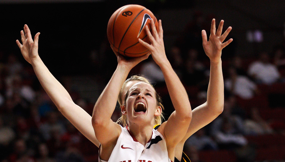 Oklahoma's Whitney Hand shoots in front of Milwaukee's Courtney Lindfors in the first half of an NCAA college basketball game in Norman, Okla. on December 11, 2011. (Photo by Sue Ogrocki) (via Boston.com)