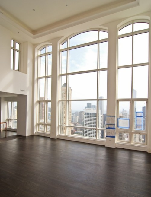 Sensational floor-to-ceiling windows display a breathtaking city view in this urban apartment (via : Features - Ceilings and Windows / Gorgeous)