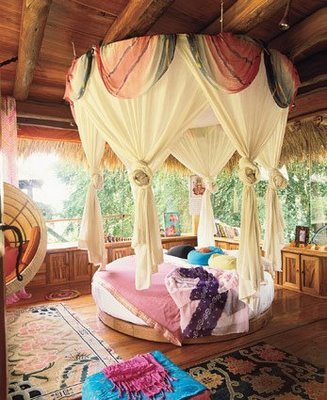 A Bohemian style room with a wonderful round bed, accented with a draped canopy (via Treasures Of Albion: Hippie Decor)