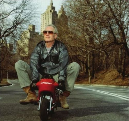 Paul Newman on a mini bike in Central Park.