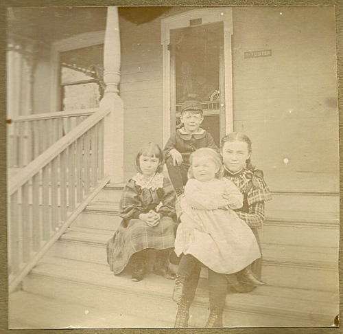Lucile (12), Mary (8) and Dorothy Fleming (1) sit with their cousin Laurence Foster (6) on their Uncle's porch in Albion, Michigan in 1896. This photo album is one of my favorite things I own.