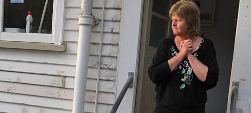 Lynn Jelley stands at the back door of her Aranui home.