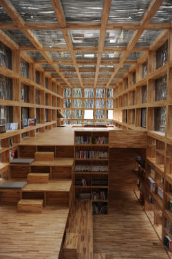 micasaessucasa:  Reading in China: Liyuan Library by Li Xiaodong Atelier   I love the way the bookshelves become a part of the room instead of something in the room.