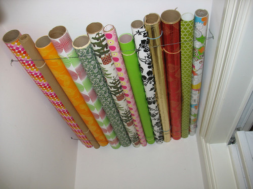 "wrapping paper storage solution by frankfarm on Flickr. Use the (almost always) unused storage space at the top of a closet or rolls of paper.Via Flickr: ""I had some wasted ceiling space in a closet as well as a need to organize wrapping paper, so I put together this storage solution. It's only 4 anchors and screws and some galvanized wire. Before this, I had tried 3M decorating clips and thread, but it wasn't strong enough to hold this much weight. """