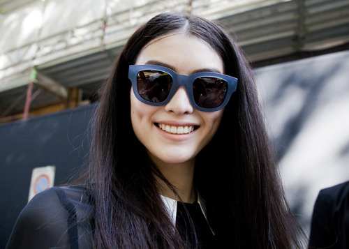 I wish I had adorable dimples like Liu Wen! The perfect accessory to the other perfect accessory - a pair of fantastic sunglasses.  via Bonae L'Amour