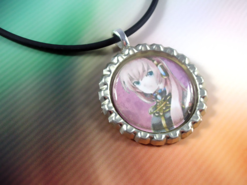 Vocaloid earrings are AVAILABLE AT OUR SHOP! Check them out!! http://www.etsy.com/shop/RedLotusDesignz?section_id=10545540