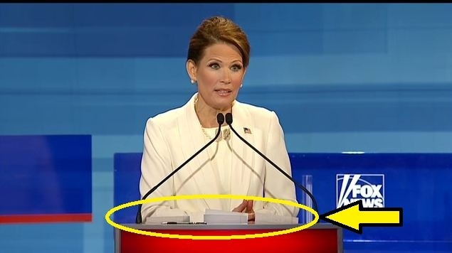 Michele Bachmann's note cards are all over the place tonight.