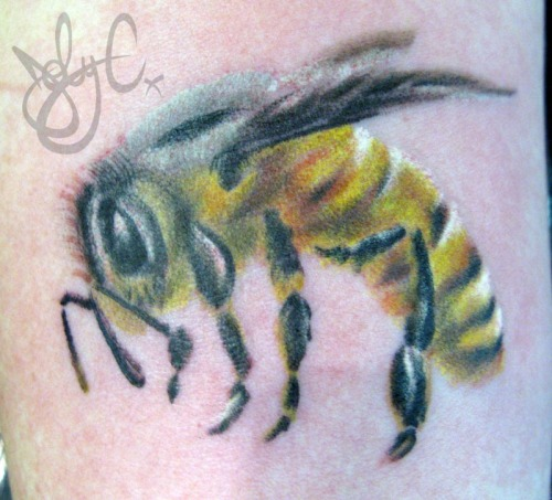 the best little bee I have ever tattooed .. it's only 2.5 inches across. ( it might be smaller )