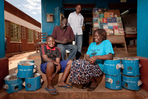 Betty Willobo laughs with her 3 sons at their store. Learn more how Betty is improving her own life and those in her community through the sale of charcoal-efficient stoves at www.theadventureproject.org.
