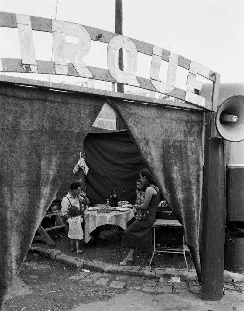 legrandcirque:  The traveling Falck Family Circus eating in a tent before a show. Photograph by Loomis Dean. France, 1952.