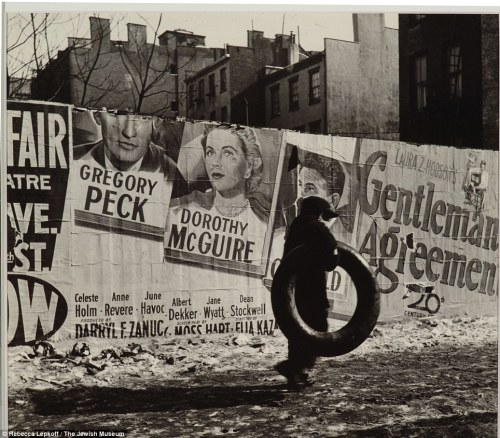 Slums. This photo from 1947 in the Lower East Side shows an advert for the  film Gentleman's Agreement, which addressed the persistence of  anti-Semitism in the U.S.