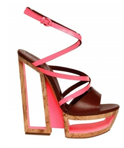 shoephoric:  The Casadei Sculptured Heels from the SS 2012 collection is shoe art at its finest! The high fashion retro hollow heel is perfectly mellowed with the soft brown insole; while its slim neon pink wrap-around straps seductively accentuates the arch and silhouette of the feet. Shoephoric!!!