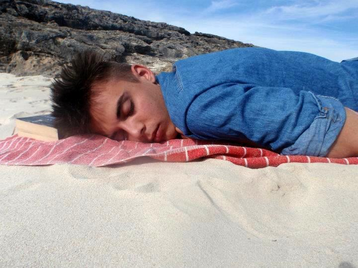 This is why I love summer break. Finding photos of you on holiday asleep on the beach with a good read. (The Line of Beauty by Alan Hollingurst-read it)