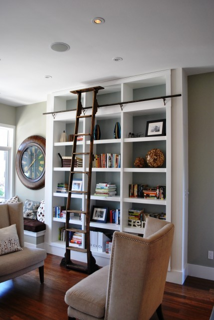 Tall built-in bookshelves turn this section of a living room into a mini-library (via Tanner Vine - 2Go Custom Kitchens Inc)