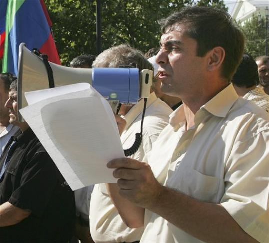 "thepoliticalnotebook:  Outspoken Russian journalist Khadzhimurad Kamalov was gunned down ""in a hail of bullets"" late Thursday night outside his office in Makhachkala, the capital of Dagestan. The 46 year old was a prominent journalist and newsman and was the founder of Dagestan's weekly newspaper Chernovik, known for its willingness to criticize officials and its work to uncover police abuse in the counterterrorism efforts in nearby Chechnya. Kamalov was known for his criticisms of and investigations into Dagestan's Interior Ministry. In 2009, his name was on a circulated ""assassination list.""  His death is a huge blow to freedom of speech and the press, and the willingness of activists and journalists to speak out in Russia. Chernovik's editor, Biyakai Magomedov, who witnessed the murder, said ""They deliberately killed him in front of the newspaper's office to scare the staff."" Author Yulia Latynina told Ekho Moskvy radio ""Just as Politkovskaya's death meant the loss of information about Chechnya, Kamalov's death will mean that to a large extent we will stop to understand what's going on in Dagestan. People will simply be scared to write anything."" Read the stories at the AFP, Boston Globe and the Guardian. [Photo: Sergei Rasulov/AP File]"