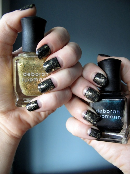 Fancy Nails!!: Deborah Lippmann - Don't Tell Mama Deborah Lippmann - Boom Boom Pow OPI - RapiDry Top Coat This didn't come out exactly as I'd hoped.  Don't Tell Mama is actually a very dark teal color, but when I put Boom Boom Pow over it, it just looked black.  For next time I know Don't Tell Mama shouldn't be worn with anything over it! 1. Paint all the nails with two coats of Deborah Lippmann Don't Tell Mama, leaving the moons exposed.  If you have a very steady hand go for it free hand but if not try using scotch tape as a template.  Cut the tape so it has a dome shape on one end and stick to the nail covering the nail bed by the cuticle. 2. Allow to dry completely and remove the tape carefully so the moons are exposed. 3. Apply Deborah Lippmann Boom Boom Pow over the painted part of the nail.  (not over the exposed moons.) 4. Apply OPI RapiDry TopCoat over the entire nail. 5. Apply OPI RapiDry TopCoat to the entire nail.