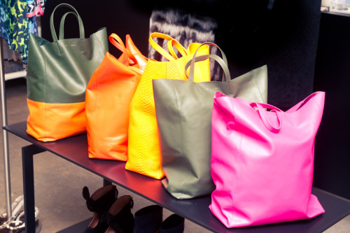 The chicest way to schlep. thecoveteur:  Electric neon skin clad Céline ladies.