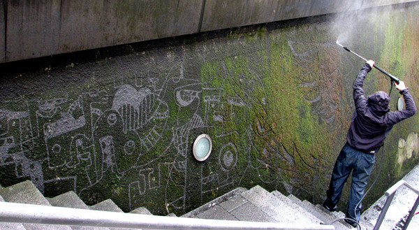 laughingsquid:  Murals Pressure Washed Into A Mossy Wall
