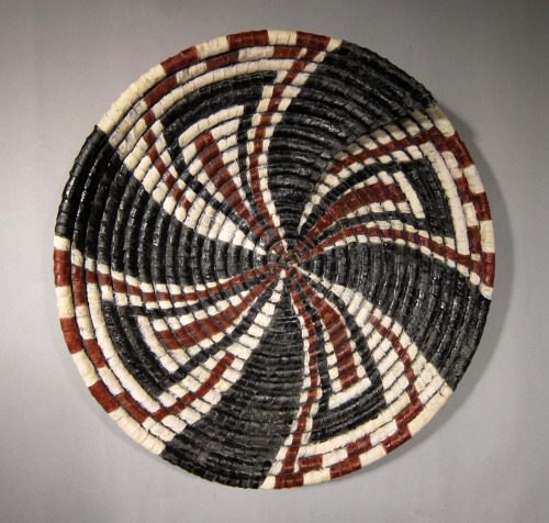 "Kathy Pallie: Wind – movement. Earthenware, glazes, 18"" Diameter x 5""D, 2011"