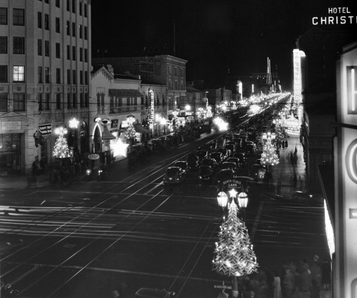 Circa 1940s Hollywood decorated for the holidays. The view looks east down Hollywood Boulevard from the corner of Hollywood and Highland.