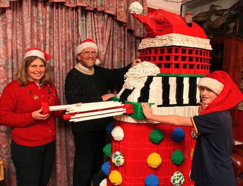 Doctor Ho Ho Ho: Family make 7ft festive Dalek from 100,000 lego bricks  The most evil being in the universe  isn't the first thing that comes to mind when you consider Christmas –  even when it's made out of Lego. But you can't blame the Addis family for knocking up this impressive 7ft Dalek complete with a Santa hat out of the toy bricks. After  all, they've pretty much exhausted every festive idea over the past 18  Christmases, using thousands and thousands of Lego pieces to create  everything from a snowman to a giant angel and a snow-covered church.