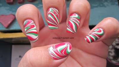 Christmas water marble! I was having SO much trouble with this.  None of my reds and greens would cooperate with each other, so a couple days ago I went out and bought a new red hoping it would work with the greens I had.  It worked.  It was still obnoxiously difficult, and I redid every finger at least twice, but I managed! Lol. Colors used: Sally Hansen X-treme Wear - Cherry Red, Going Green Wet N' Wild - French White Creme