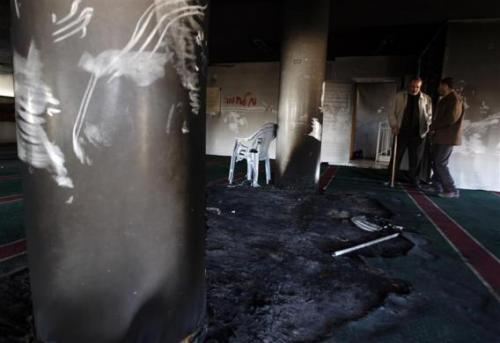 war-sucks:  Palestinians inside a damaged mosque in the West Bank village of Burka, which was burned on Thursday. Extremist Israeli settlers are thought to have committed the crime in retaliation for the Israeli army dismantling an unapproved settlement earlier this week.  (Photo via Reuters)  Those fuckfaces are terrorists.   Burning buildings for no reason (or to retailate) is not acceptable behavior.  This was not an act of self-defense.