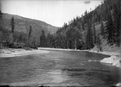 Big Blackfoot River. Photograph by Edward H. Boos, 1905(?).Trees and several tree stumps line the shores of the Big Blackfoot River in western Montana. A ridge of mountains is in the background. History of the American West, 1860-1920: Photographs from the Collection of the Denver Public Library (Library of Congress, American Memory)