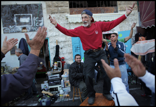 tkalifa:  A spontaneous dance party erupts on the edge of the famous Jaffa flea market on a Thursday afternoon. The sound of Middle Eastern rhythms permeate the market and occasionally result in a celebration to the amusement of locals and tourists alike. Jaffa, Israel.