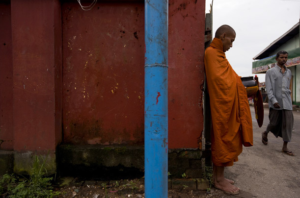 A monk begs near the river. Burma/Myanmar, 2007. [Credit : James Nachtwey] [via]