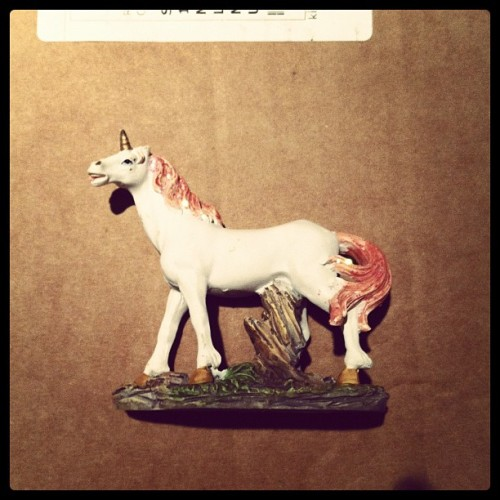 sademica:  Finally got a #unicorn ornament, it's not the clock, but it will suffice. (Taken with instagram)  that trunk looks very uncomfortable